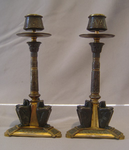 French 19th century Egyptian revival candlesticks in patinated bronze and ormolu.