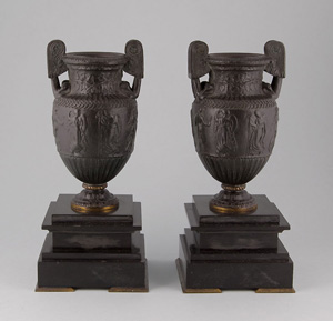 Pair antique French patinated bronze and marble urns.