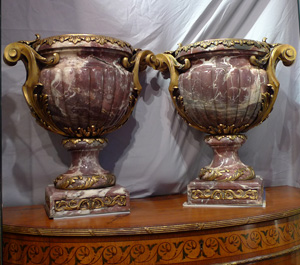 Antique and monumental pair of ormolu mounted breche violet urns.