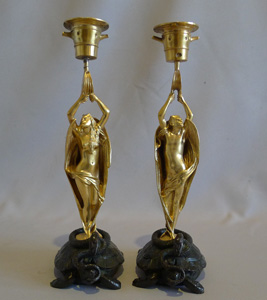 Antique pair of very unusual figural devil bronze candlesticks.