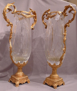 Pair of massive glass and gilt bronze vases.