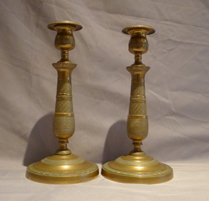 Pair of bronze candlesticks in the Empire style.