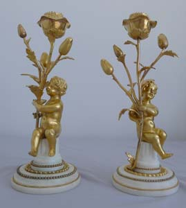 Pair Antique French figural candlesticks in Louis XVIth style of ormolu and white marble.