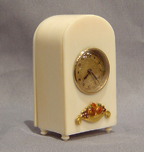 Antique Swiss miniature ivory, gold and enamel clock.