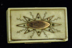 Antique English ivory and gold vinaigrette.