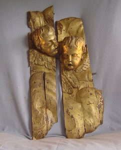 Pair Italian antique 17th century open mouthed carved and gilded heads of putti.