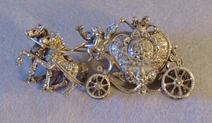 Silver and marquesite watch broach.
