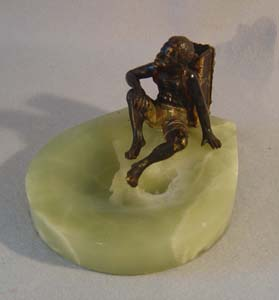 Austrian bronze of a negro match strike on a green onyx ashtray
