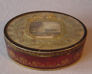 Antique English Regency cranberry glass and toleware box with inset embroidery on silk satin.