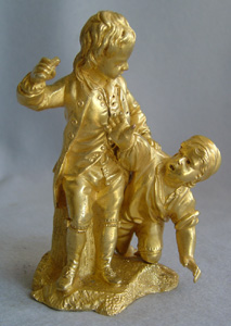 Early 19th century gilt bronze group of two boys with a bird.