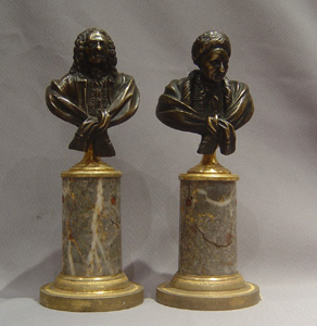 Antique bronze busts of Voltaire and Rousseau on fine ormolu mounted marble bases.