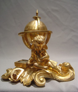 French antique ormolu inkwell with globe and cherub.