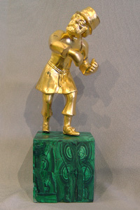 Russian gilt bronze figure of an old man on Siberian malachite base.