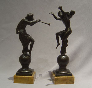 Antique and fine pair of Italian grand tour bronzes on Sienna marble bases.