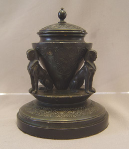Antique French Egyptian Revival inkwell held by three sphinxes