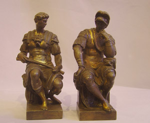 Pair of Italian Grand Tour gilded bronzes of the Medici brothers by Michaelangelo.
