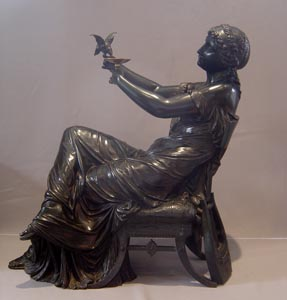 Fine French classical bronze of a woman reclining on a chair.
