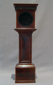 Watch stand in form of inlaid mahogany longcase clock.