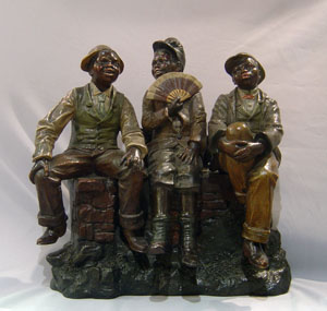 terracotta of three black city boys.