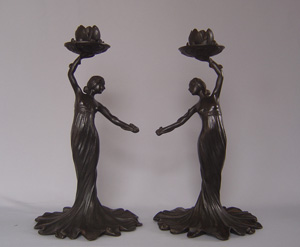 Russian Art nouveau candlesticks, a pair and in cast iron.