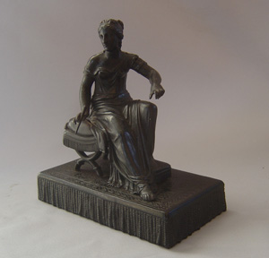 Antique Grand Tour bronze of woman on French Empire stool.