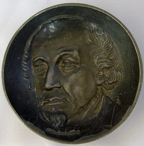 Antique sculpture of Disraeli in a Pewter dish.