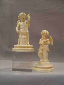 Ivory antique carved cupids, European,a pair, superbly carved