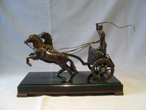 Antique Grand Tour bronze of charioteer on marble base.