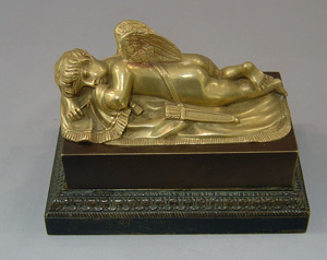 Antique French Empire inkwell with cupid asleep.