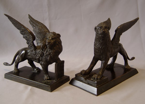 A matching pair of Grand Tour St. Marks winged Lions in patinated bronze.