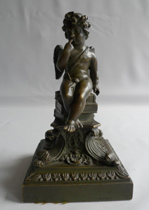 Antique English Regency bronze of winged cupid on fine base.