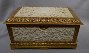 Antique carved ivory and ormolu casket.