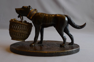 Antique English Regency sculpture of dog with basket in patinated bronze and ormolu .
