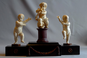 European 18th century ivory group on breakfront base.