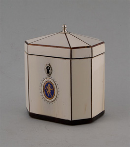 Antique tea caddy in tented ivory, strung with tortoiseshell with silver fittings.