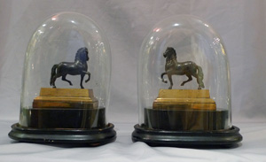 Pair English Geoge IV gilt lacquered models of classical horses, on bases and under domes.