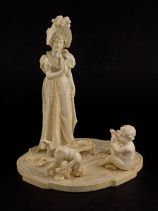 Ivory group of woman with two children, European.