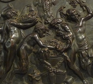 Antique bronze plaque of bacchanalian romp.