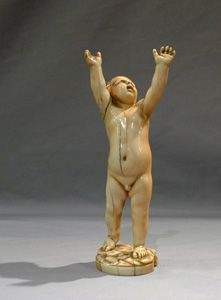 Antique ivory figure of a putto, European17th century.