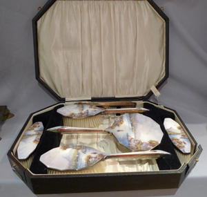 Silver and enamel dressing table set cased of mirror, brushes and combe