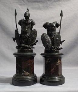 Pair antique grand tour bronze trophies of war on black marble and shaped variagated marble stems.
