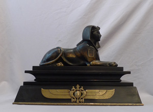 Antique Egyptian revival bronze of the Sphinx on bronze mounted black marble