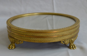 Antique mirrored and gilt bronze table stand in Empire style