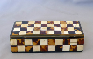 Antique harlequin box in horn, tortoiseshell and ivory box.
