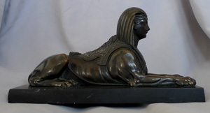 English Regency Egyptian revival sphinx on black marble base.