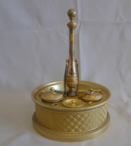 A French Empire ormolu inkwell.
