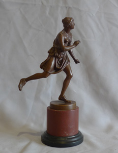 Antique Grand Tour bronze of female athlete after the antique and signed Barbedienne.