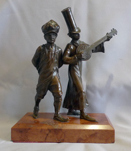 Austrian bronze of two negroes in New Orleans style dress on marble base.