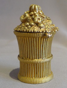 Antique inkwell with hinged lid and modelled as a sheaf of corn.