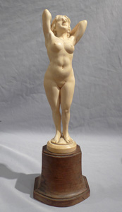 An early 20th century ivory nude on shaped base.